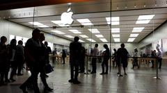 Customers line up outside of the Apple Store Stock Footage