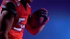An American football player training with ball Stock Footage