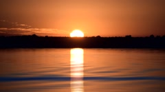 Time lapse of gorgeous sunrise over water of lake or river Stock Footage