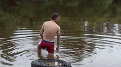 Man enters into the cold water Stock Footage