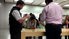 Customers trying new released iPhone 7 and 7 plus inside Apple store Stock Footage