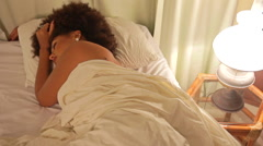 A Single Lonely Beautiful Woman Waking Up in Bed at Home Stock Footage