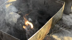 Build a fire with charcoal to grill the food Stock Footage