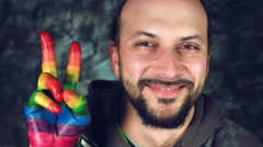 4k LGBT Shot of Rainbow Coloured Hands Man Showing Peace and Victory Stock Footage