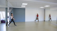 Models practice in defile before fashion show in dancing room Stock Footage