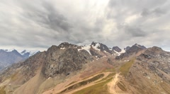 Clouds over snowy peaks. Talgar Pass, Chimbulak. Almaty. Kazakhstan Stock Footage
