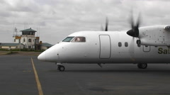 Twin engine prop-plane on airport tarmac. Stock Footage