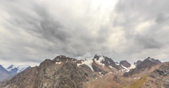 Clouds over snowy peaks. Time Lapse. Chimbulak. Almaty. Kazakhstan. TimeLapse Stock Footage