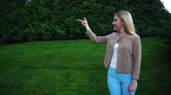 Young Beautiful Blond Female Point Fingers Hands to Empty Space Stock Footage
