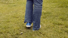 Girl walking over the grass Stock Footage
