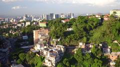 Aerial Rio de Janeiro city and Santa Teresa hill with slums in Brazil Stock Footage