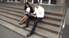 Young Asian Beautiful Business Woman Female and Caucasian Male Use Documents, Stock Footage