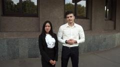 Young Beautiful Business Woman Female Girl and Caucasian Male Portrait Look at Stock Footage