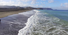 Aerial of crashing waves on beach at Pacifica, San Francisco Stock Footage