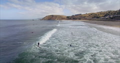 Aerial of surfer entering the water at pacifica, San Francisco Stock Footage