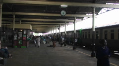People move about the platform where a train is. Stock Footage