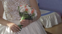 Beautiful bouquet of different colors in the hands of the bride in a white dress Stock Footage