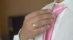 Groom in a wedding jacket with boutonniere Stock Footage