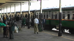 People walk along side of a train in a station. Stock Footage