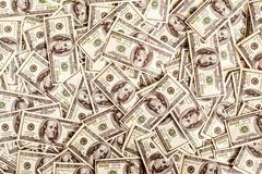 Many 100 dollars background Stock Photos