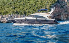 Motor yacht under way out at Adriatic sea, Montenegro Stock Photos