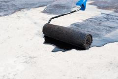 Roller brush, waterproofing Stock Photos