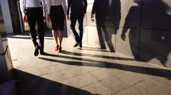 Business Team Walking With Shadows Light Near Center Office Stock Footage