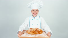 Portrait young baker holds cutting board with braided bread and gives loaf Stock Footage