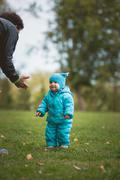 Happy family walking in autumn park: father and his little son - learn to stroll Stock Photos