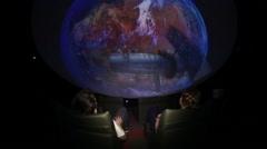 Spherical cinema.360. People sit in the cinema.Viewing science films . Stock Footage