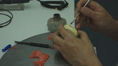 The dental technician in the dental laboratory is engaged in manufacturing Arkistovideo