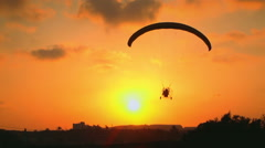 Extreme Sports Flying Paragliding on a Paraglider Landing at Sunset  Stock Footage