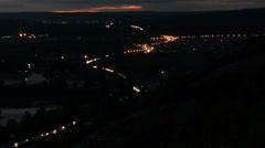 Night city Highway. Car traffic on night road. Setting sun. The river, mounta Stock Footage