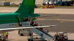 Passengers Boarding Plane / Aircraft from the apron / tarmac - Rear Stock Footage