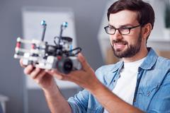 Positive man holding robot Stock Photos