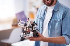 Cheerful smiling man holding robot Stock Photos