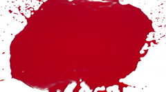 Red drops falls and splatters on white. juice Stock Footage