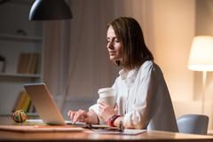 Beautiful woman finishing her work in an office Stock Photos