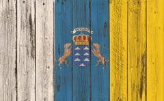 Flag of the Canary Islands on wooden background Stock Illustration