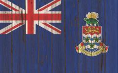 Cayman Islands flag on old wood texture background Stock Illustration