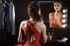 Attractive female model caring of appearance Stock Photos