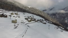 Winter landscape - Mountain village - Aerial view Stock Footage