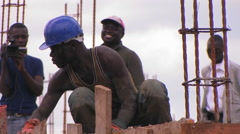 Men work on a construction job. Stock Footage