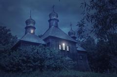 Old European church in a full moon night Stock Photos