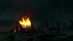 People celebrate St John's Eve by burning many bonfires in a beach Stock Footage