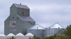 Old grain elevator with new modern storage container beside it. Stock Footage