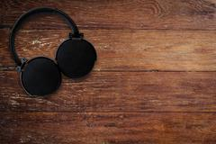 Headphone on wood background and texture with space Stock Photos