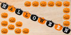 Halloween flags , black and orange flags on wooden background Stock Photos