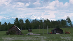 Two cabins with mountain backdrop Stock Footage