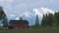 House with mountain backdrop Stock Footage